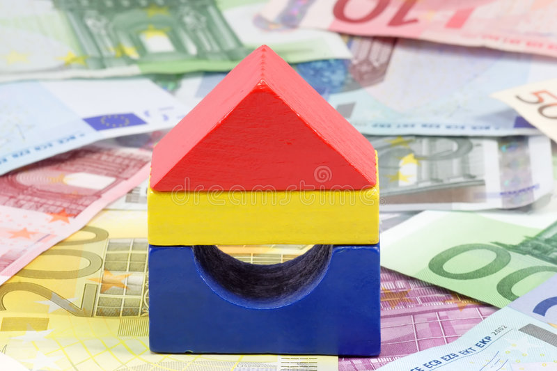 House financing. Colorful toy brick house with Euro banknotes royalty free stock photo