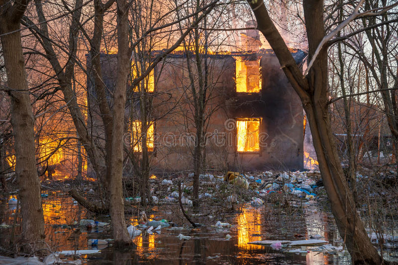 House on fire. Two-storey house covered with fire (house on fire stock photos