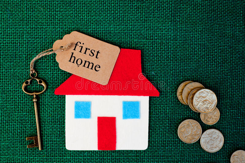 House - First Home. House with First Home key on green background royalty free stock photography