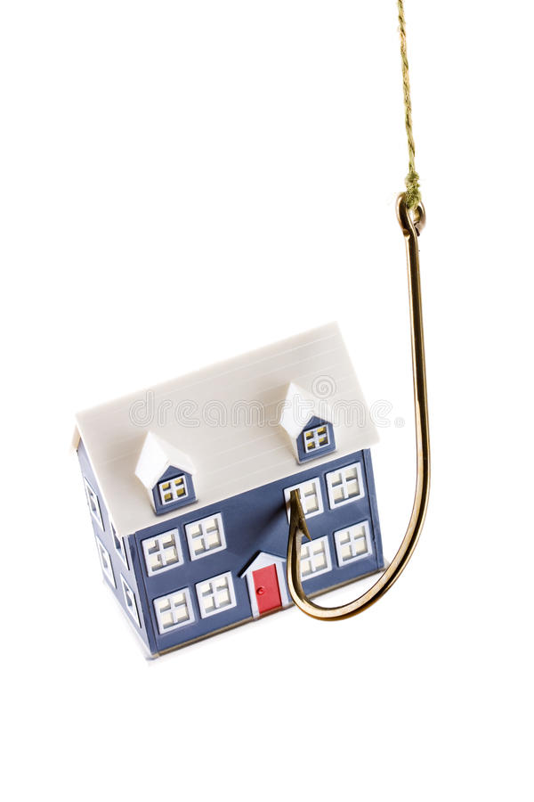 House on a fishing hook isolated. On a white background stock images