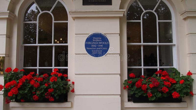Blue plaque commemorating the house of Virginia Woolf in Fitzroy Square, London. The house is Fitzrovia in which the writer Virginia Woolf lived from 1907 to stock photos