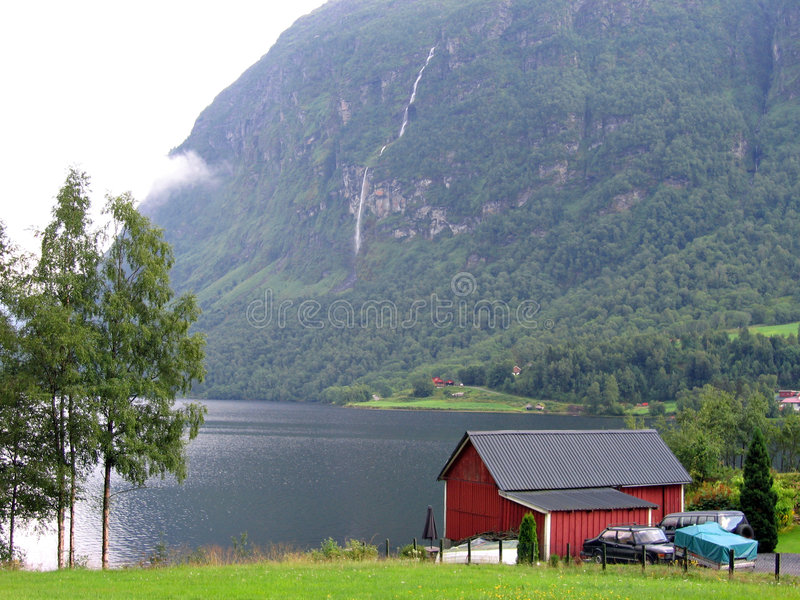 House by a fjord in Norway. Wooden house by a fjord in Norway royalty free stock images