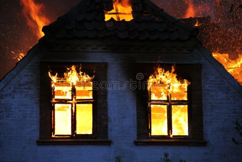 House in flames burning down. Fireblaze. stock image