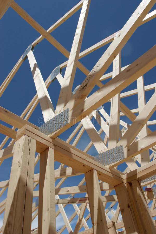 House frame construction. The seeming chaos of a house frame being constructed stock photo