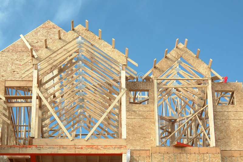 House Framing Lumber Home. New house construction during the framing stage royalty free stock images