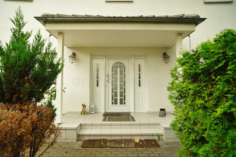 Front door of an elegant big house royalty free stock photography