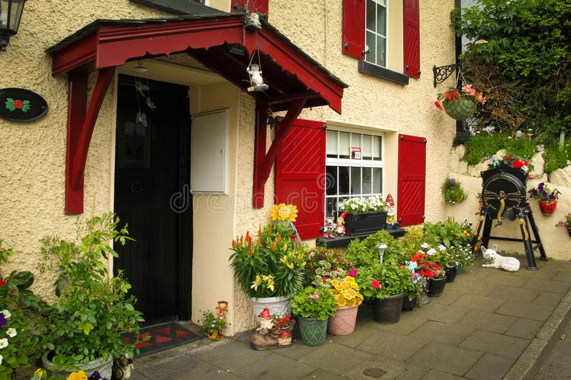 House with front garden. Inistioge. Ireland. House with front garden, gnomos and flower pots. in the scenic village of Inistioge. Kilkenny. Ireland stock image