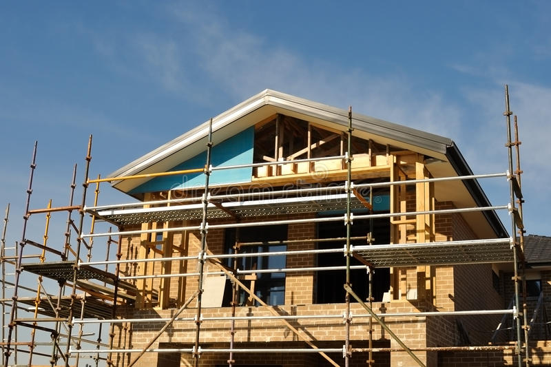 House front in scaffolds stock photos