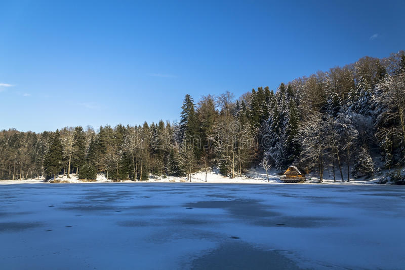 House on a frozen lake. In winter royalty free stock photo