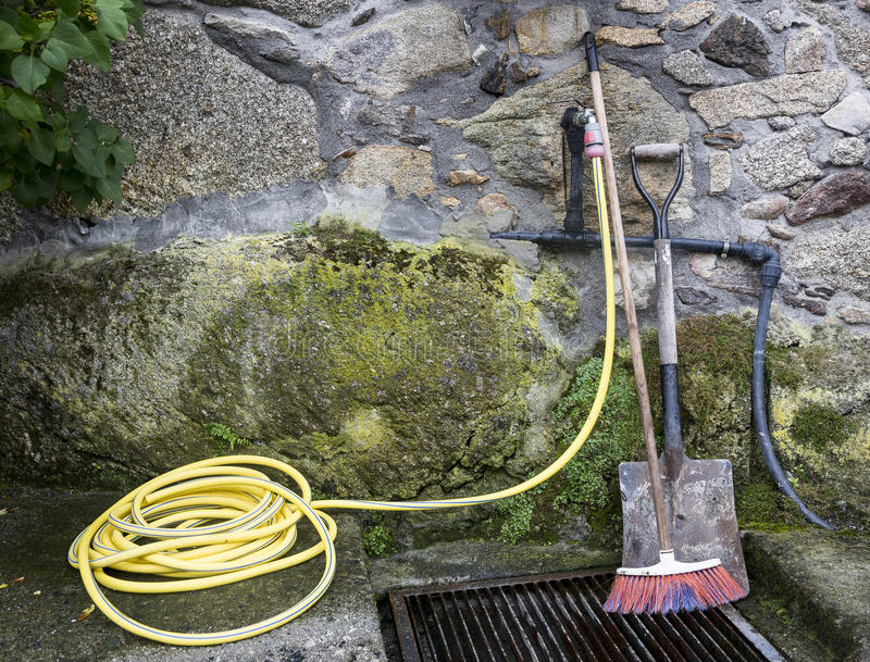Download House And Garden Cleaning Tools With A Water Hose A Shovel And  Broom Stock Photo