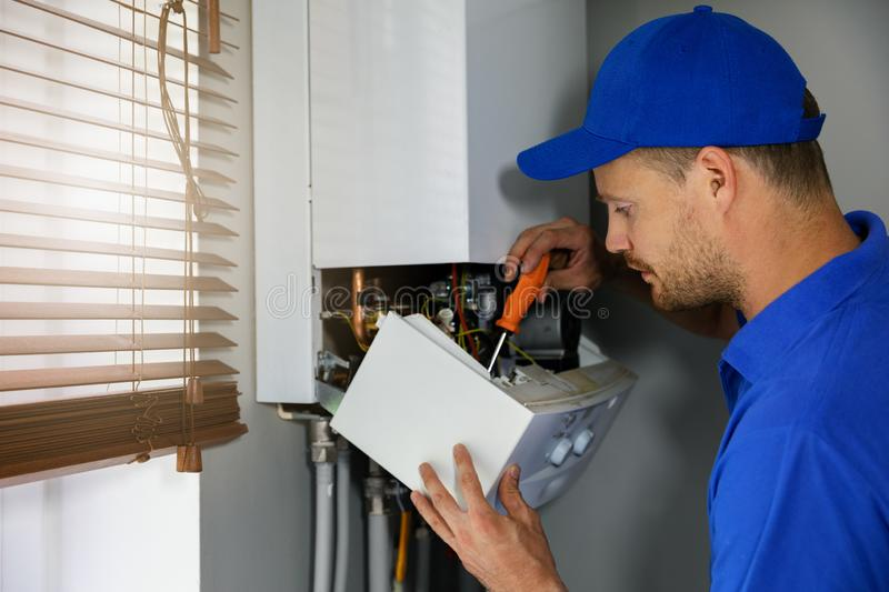 House gas heating boiler maintenance and repair service stock photography