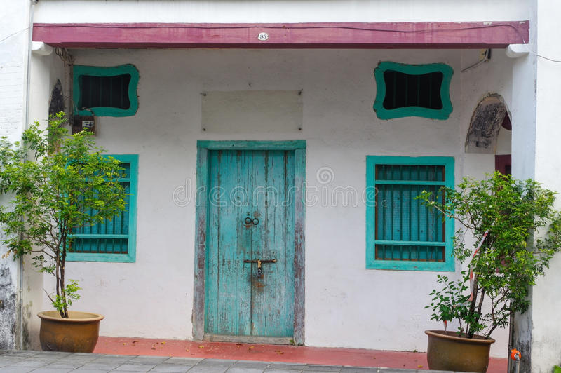 Download House In George Town, Penang, Malaysia. Mediterranean Style Exterior. Blue Wooden Doors And Window Shutters On Old Painted Wall Stock Photo - Image of character, apartment: 78091178