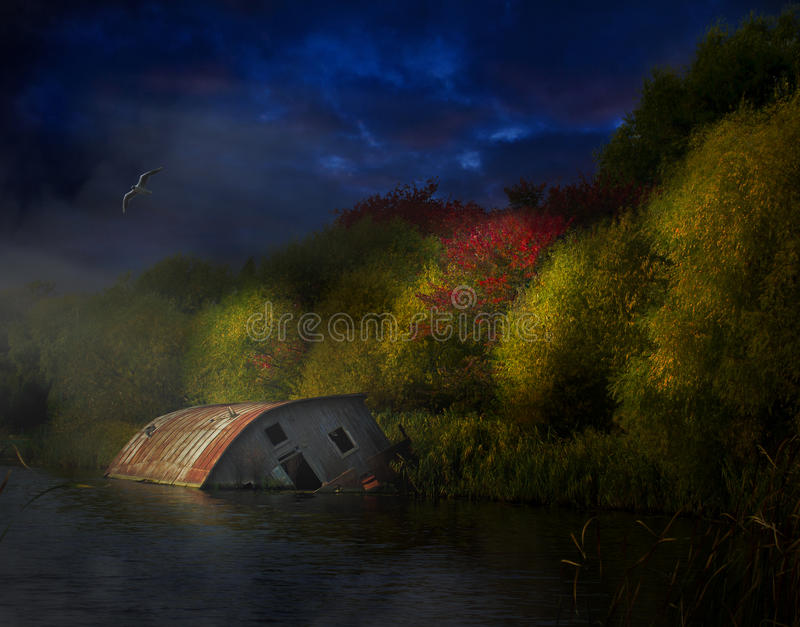 House with the ghosts. Sunken house at night on the river bank royalty free stock photography
