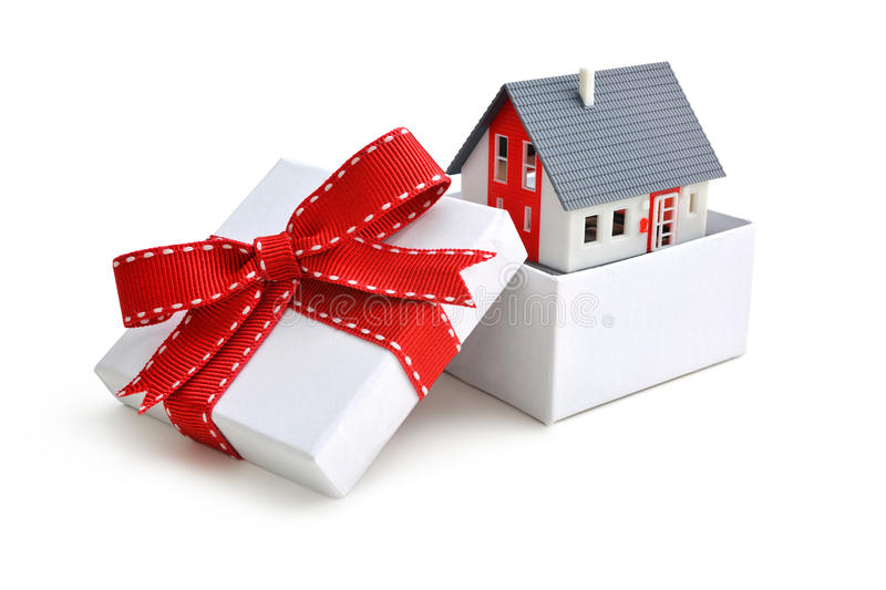 House in gift box. Model of a house in gift box with red ribbon