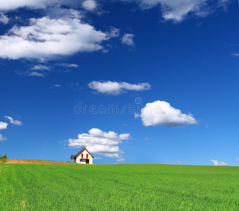 House in grass field royalty free stock photos