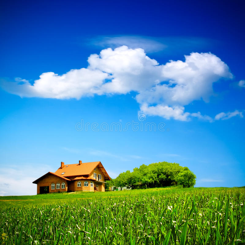 House on green field stock photo