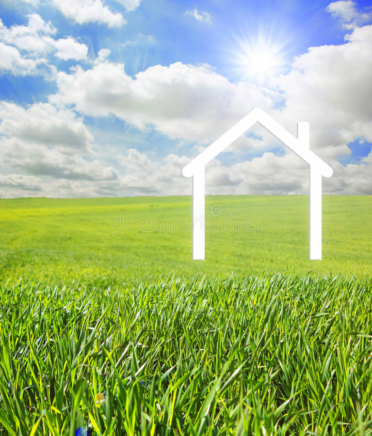 House on a green landscape. Iconic symbol of a house on a green landscape royalty free stock photos