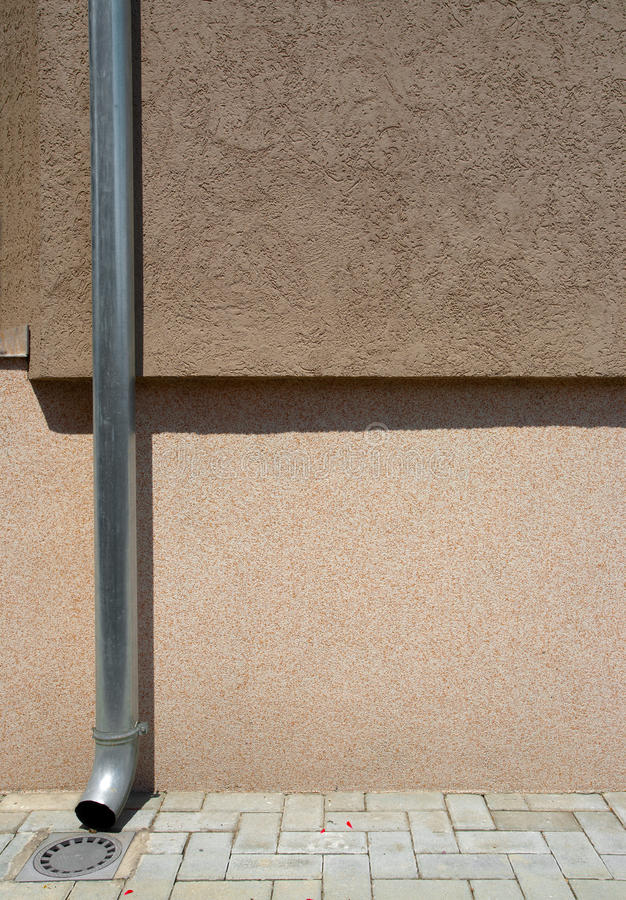 House Gutter. And wall textures in brown color stock photos