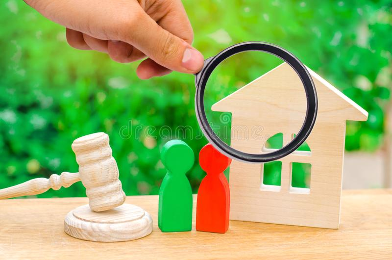 House, hammer of the judge with wooden figures of people. Clarification of ownership of property. Concept settlement. Of litigation. Rivals in business royalty free stock image