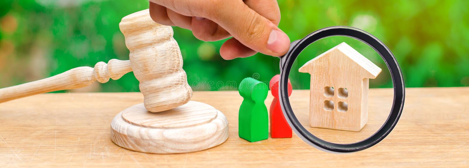 House, hammer of the judge with wooden figures of people. Clarification of ownership of property. Concept settlement royalty free stock images
