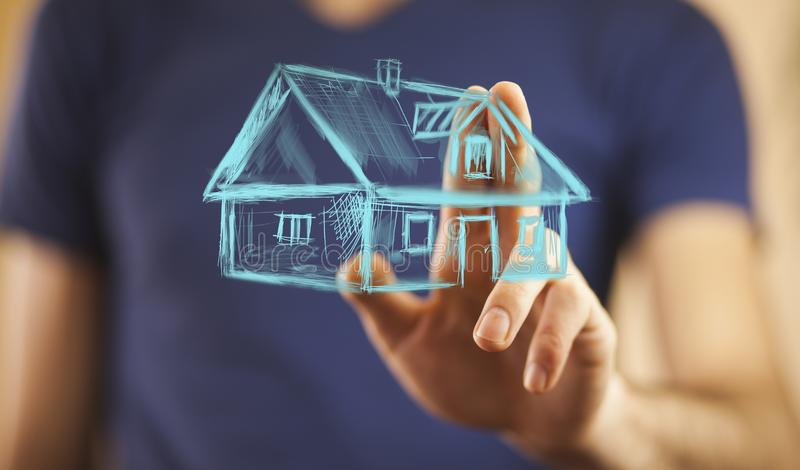 House on hand. Drawing house in man hands stock photo