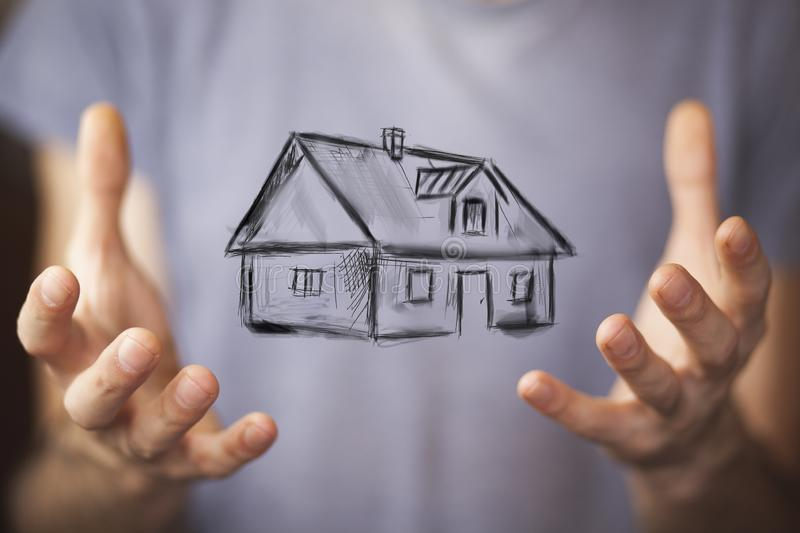 House on hand. Drawing house in man hands stock images