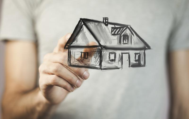 House on hand. Drawing house in man hands royalty free stock photo