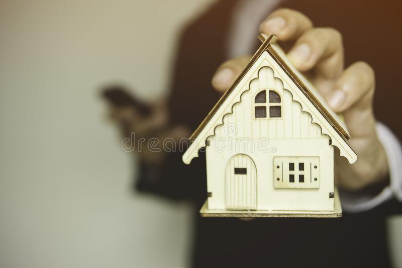 House on hand represent Planning to find housing Or saving money to buy house. royalty free stock image