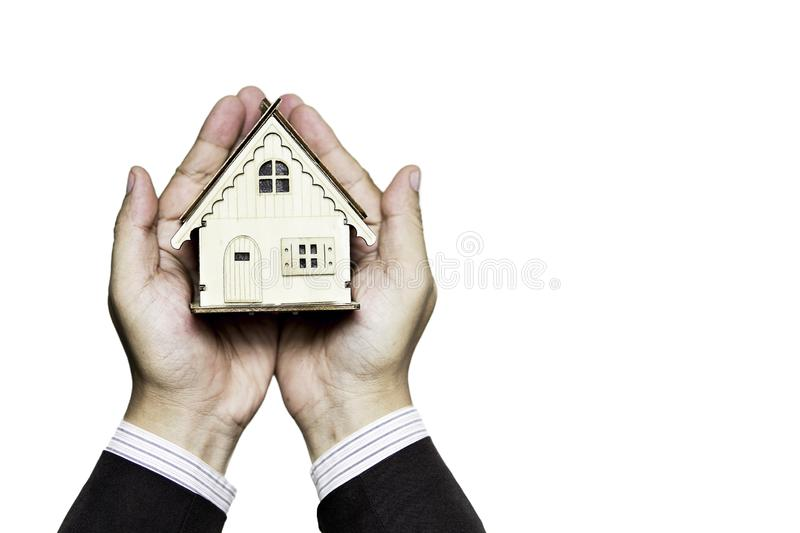 House on hand represent Planning to find housing Or saving money to buy house. stock photography