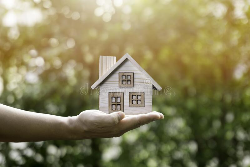 House in hand and sunlight show savings. royalty free stock photo