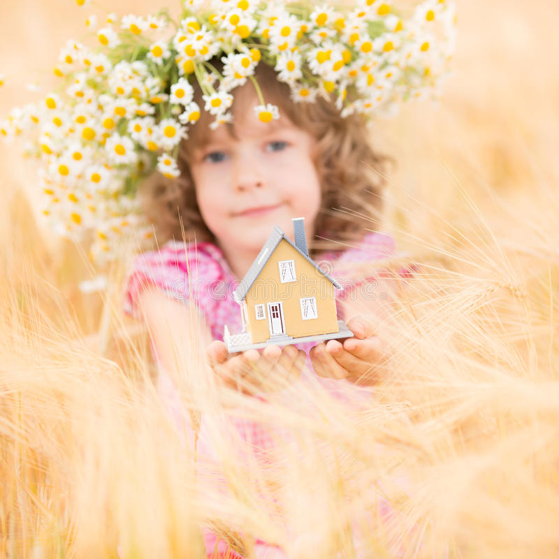 House in hands. Child holding house in hands. Real estate concept royalty free stock images