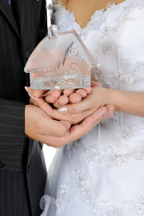 House in the hands of the newlyweds royalty free stock images