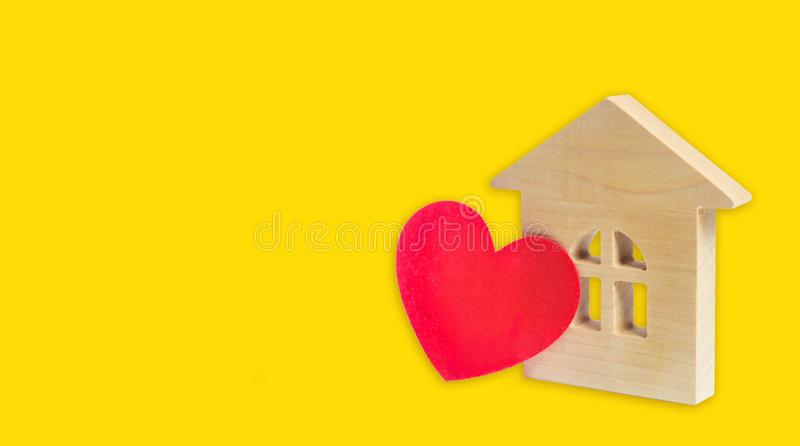 House with a heart. House of lovers. Affordable housing for young families. Accommodation for lovers of couples. Valentine`s day. House. Young family love real stock images