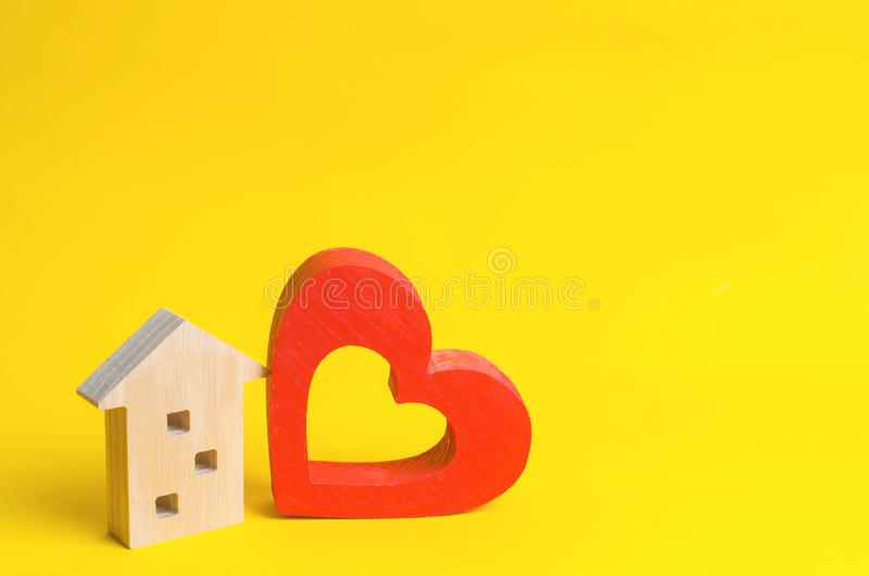 House with a heart. House of lovers. Affordable housing for young families. Accommodation for lovers of couples. Valentine`s day. Real estate. yellow royalty free stock photos