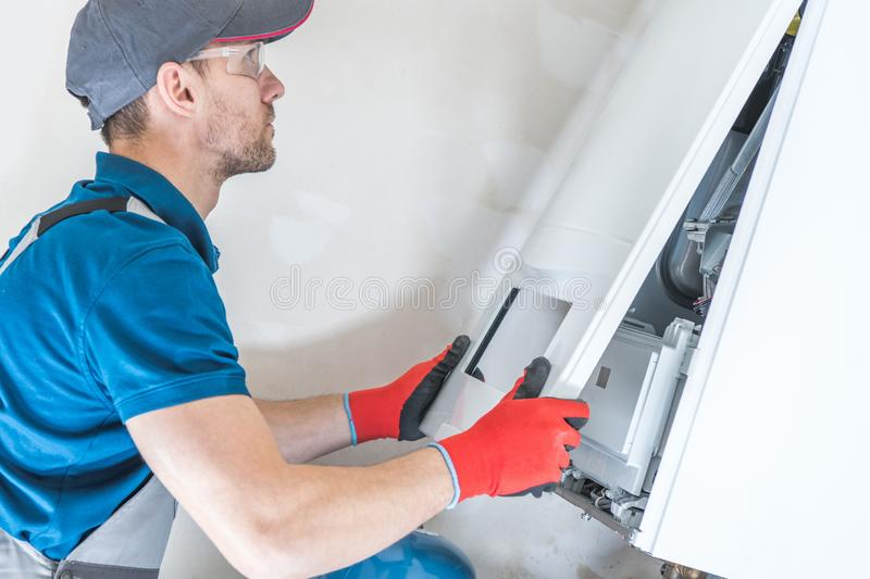 House Heating Unit Repair. By Professional Technician. Closeup Photo. Home Equipment Issues stock image