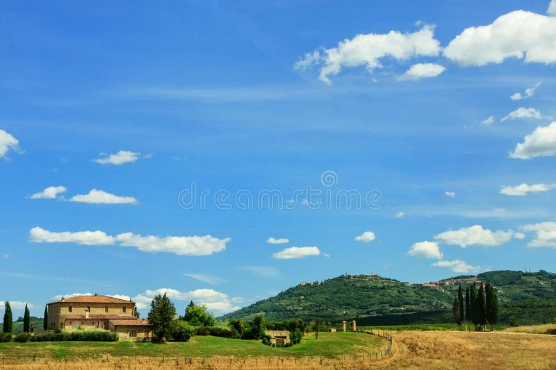 House on the hill in Val d `Orcia, Tuscany, Italy. In 2004 the Val d`Orcia was added to the UNESCO list of World Hege Sites royalty free stock photography