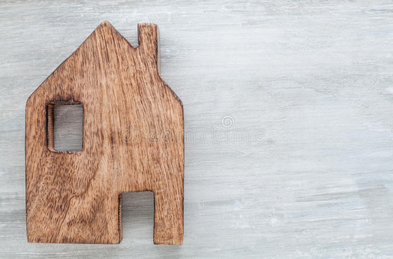 House Home Symbol. Wooden Background stock images