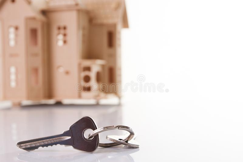 House and house keys isolated on white background royalty free stock images
