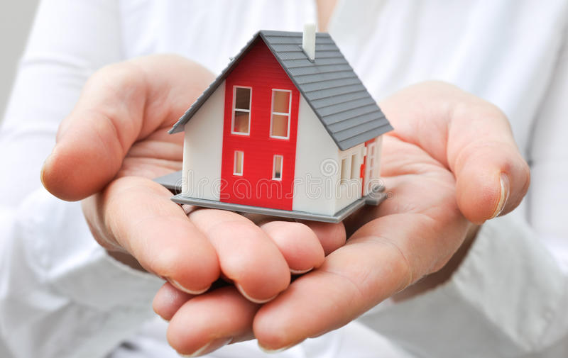 House in human hands stock photography