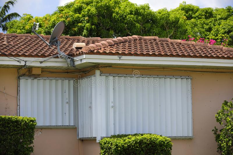 House with hurricane shutters. Image of a home with shutters for Hurricane Irma stock image