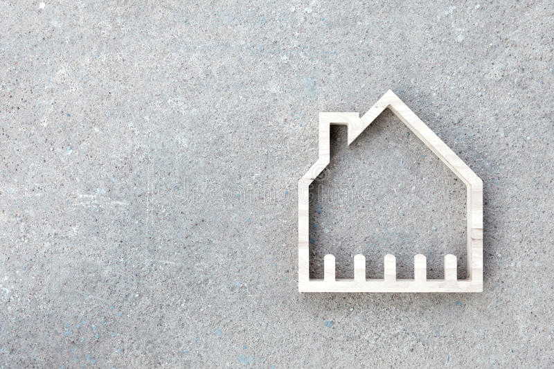 House icon on concrete background, Home construction royalty free stock photos