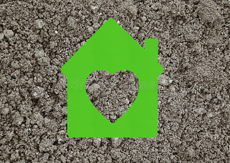 House icon on grey ground background. Green house icon on grey ground background stock photography