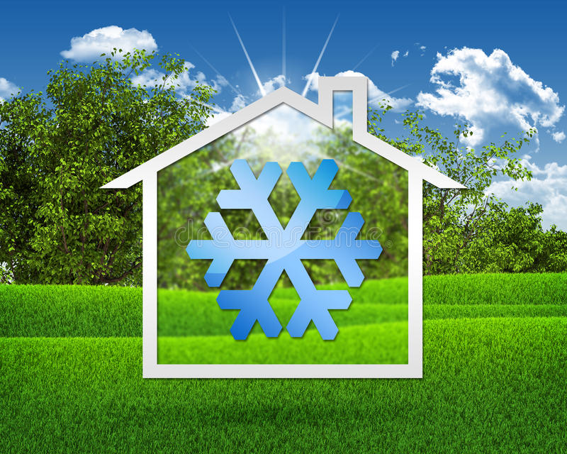 House icon with snow symbol. Green grass and blue sky as backdrop stock image
