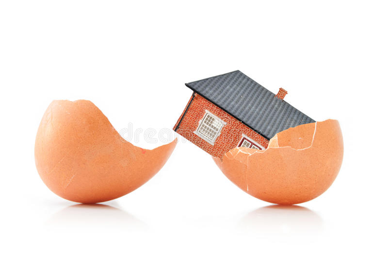 House inside an egg stock photos