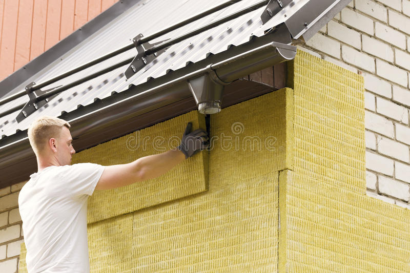 House insulation - insulating house facade with mineral woo stock photos