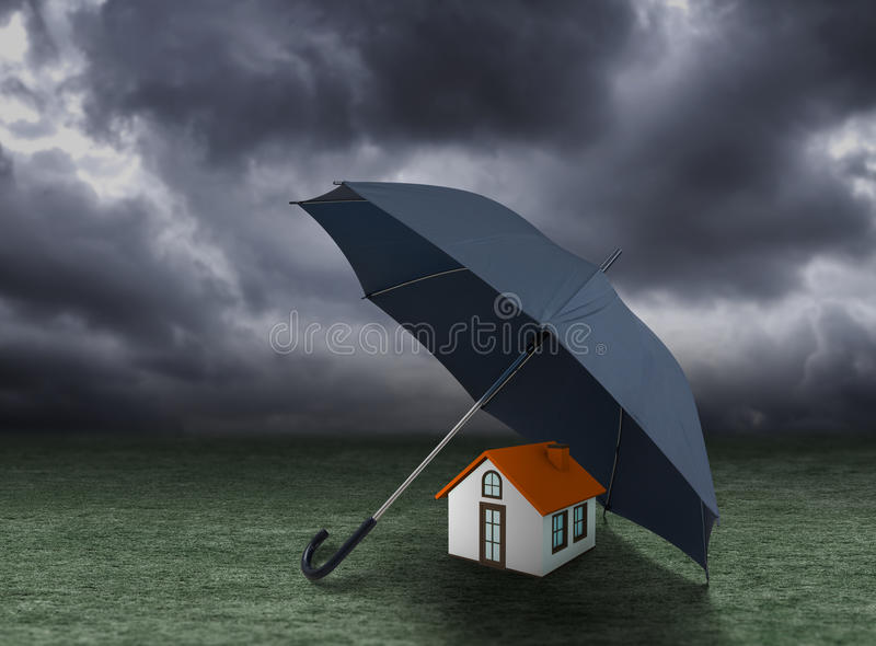 House insurance concept, house protected under umbrella royalty free stock photography
