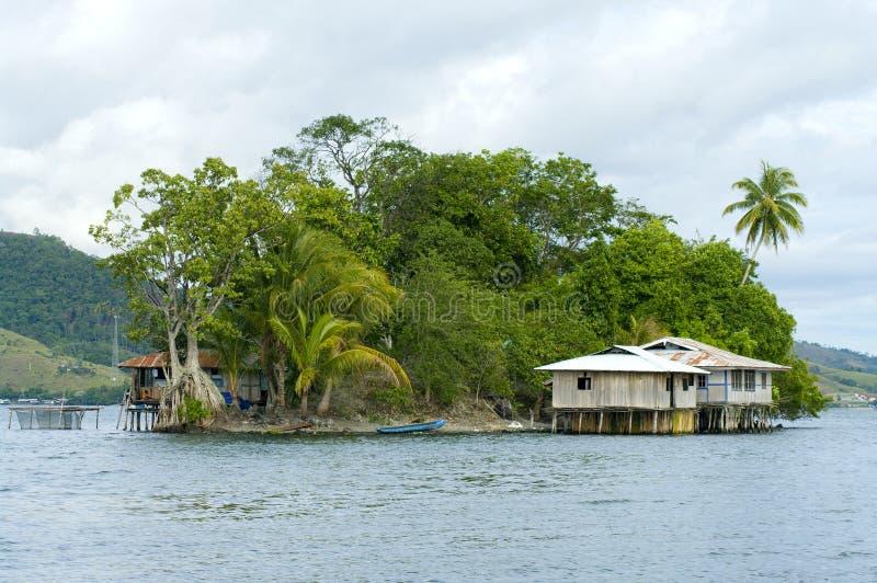 House on an island. On the lake Sentani, New Guinea stock photos
