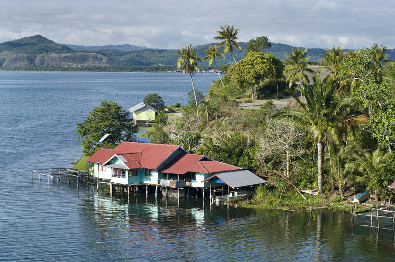 House on an island on the lake of Sentani stock photography