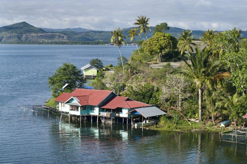 House on an island on the lake of Sentani. House on an island on the lake Sentani, New Guinea stock photography