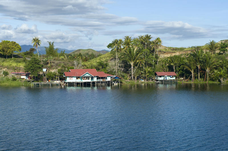 House on an island on the lake of Sentani. New Guinea royalty free stock photography